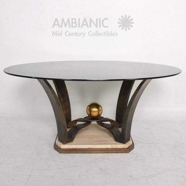 For your consideration beautiful base for a dining table or centre table. Sculptural base in patinated bronze with a travertine base.