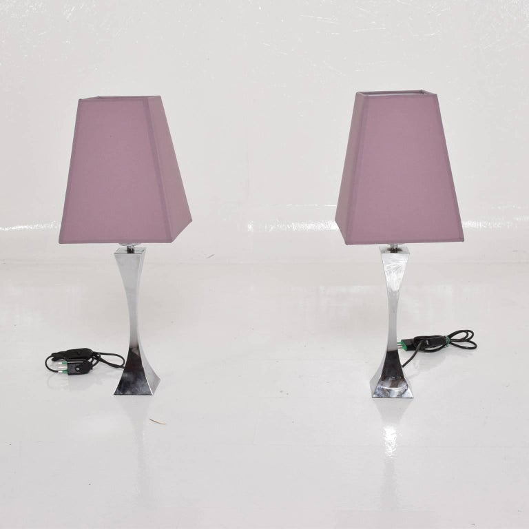 """For your consideration a pair of Italian table lamps in chrome plated steel.  Made in Italy, circa 1960s by Tonello & Montagna.  Original shades. Dimensions: 14"""" H x 3"""" x 3"""" , 22"""" H with shade.  Shade 10"""" H x 7 3/4 x"""
