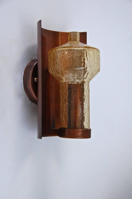 Six superb Kaiser Leuchten sconces from Germany in vintage original finish, rewired and ready for use in the US. Handblown crackled amber glass and copper.