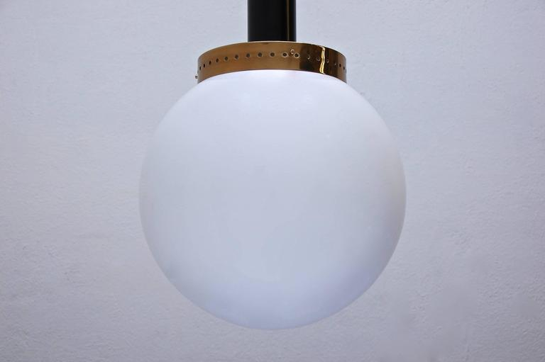 Impressive large pendant in the style of Mid-Century Modern design.