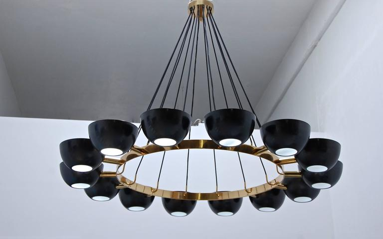 """Celebrating the genius of Gino Sarfatti, this contemporary chandelier draws from his inspiration. In a 65"""" diameter, this chandelier with 14 10"""" x 5"""" shades is quite large, yet refined and elegant. Provides indirect lighting by flooding the"""