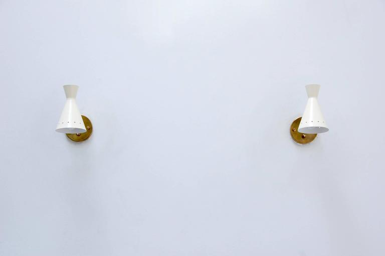 Five Perforated Articulating Sconces 8