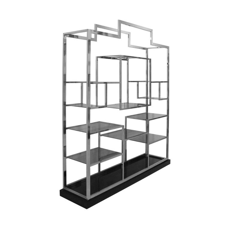 Shelves designed by Romeo Rega with structure made in steel and dark crystal with base made in black lacquer wood.