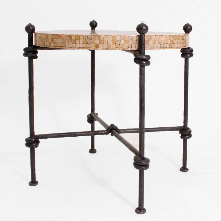 Italian side table with steel structure lacquered in black and wooden top covered with tessels in neoclassic style.