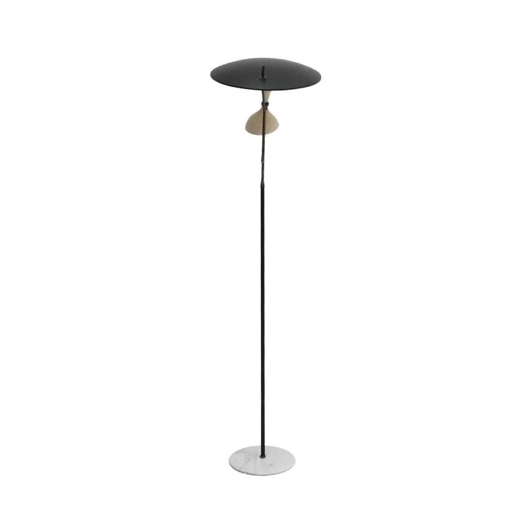 Floor lamp designed by Stilnovo. Structure made of lacquered metal in black with details in brass, metal bowl lacquered in black and white interior and base made of white marble, Italy, 1950s.