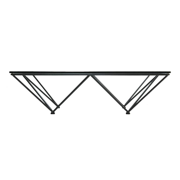 Center table designed by Paolo Piva, with structure made of lacquered metal in black with geometric shapes and transparent crystal envelope, Italy, 1970.