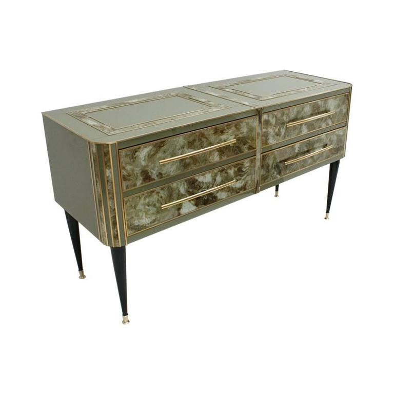 Sideboard made up of four drawers made with wood structure, coated glass hand-painted imitating a natural stone and Murano glass with details in brass. Legs made of lacquered wood in black with brass finishes, Italy.