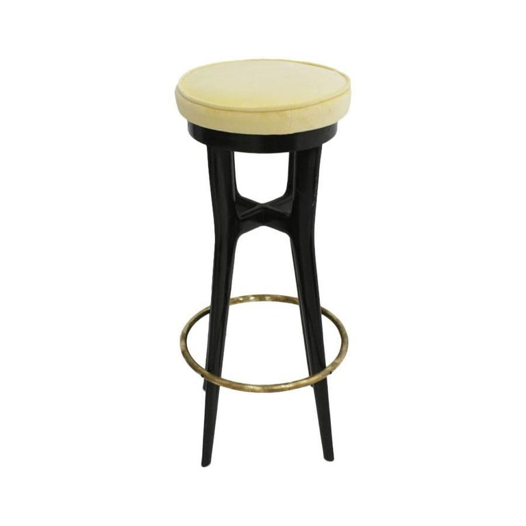 Pair of stools made in ebonized wood with details in brass and upholstered in yellow velvet, Italy, 1950s.