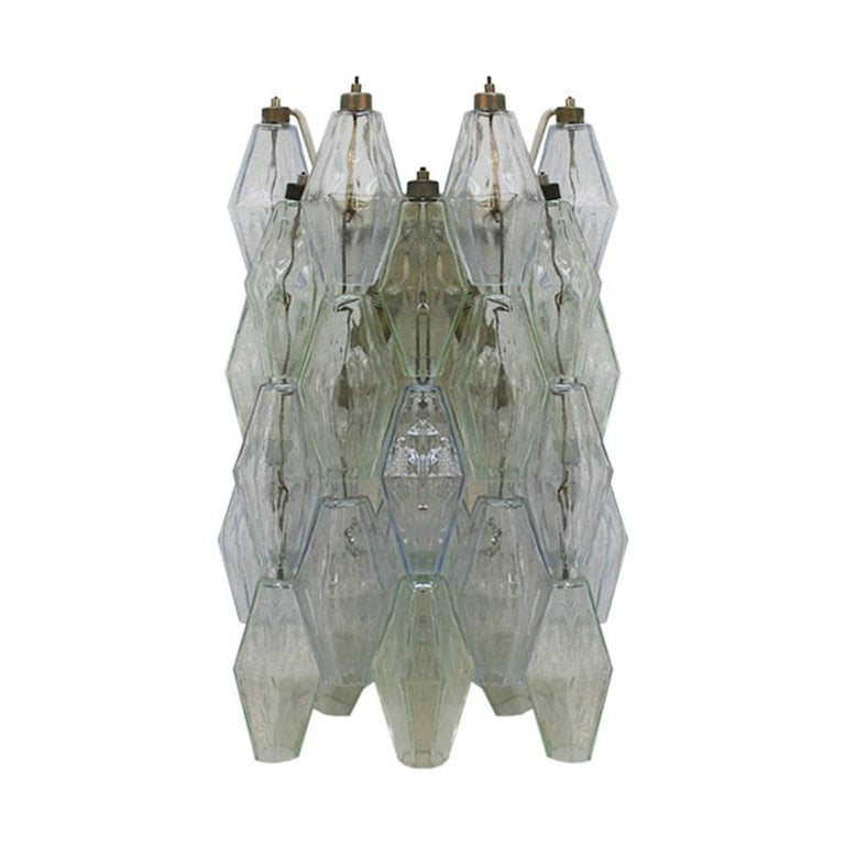 """Pair of sconces mod. """"Poliedri"""" designed by Carlo Scarpa, edited by Venini. Structure made of metal with solid crystal pieces."""