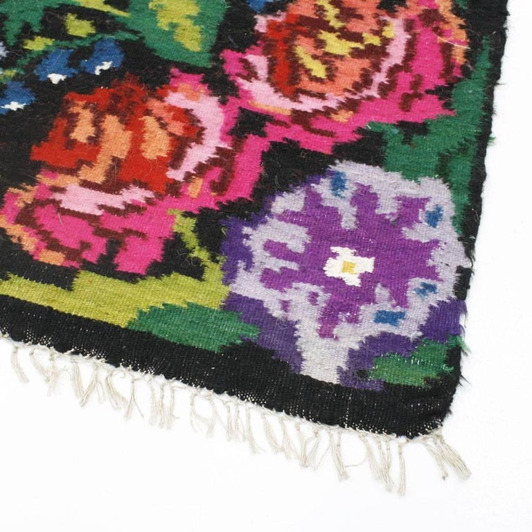 French carpet woven in wool with floral motifs.