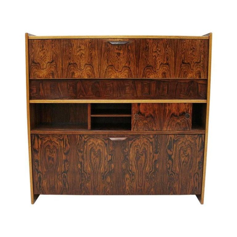 Bar made of wood covered in rosewood with marquetry circles on the front and steel details.