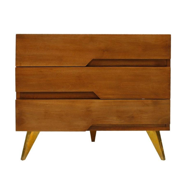 Pair of dressers composed of three drawers. Handmade in solid birch wood, with geometric decoration on the front and legs with conical shape of brass.