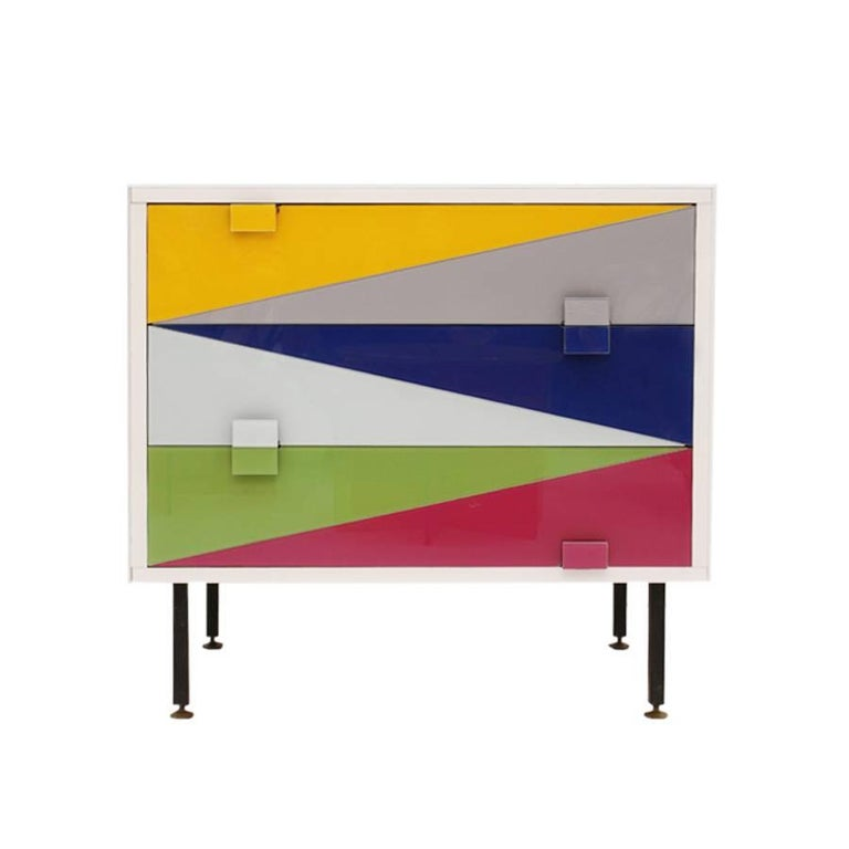 Pair of nightstands designed by L.A. Studio, with structure in solid wood, covered in colored glass and metal legs lacquered in black with pivoting bronze pickup.