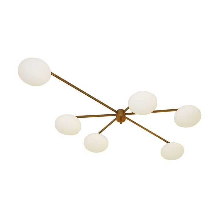 Ceiling lamp in the style of Angelo Lelli, with structure made of brass and lamp shades of opaline, Italy.
