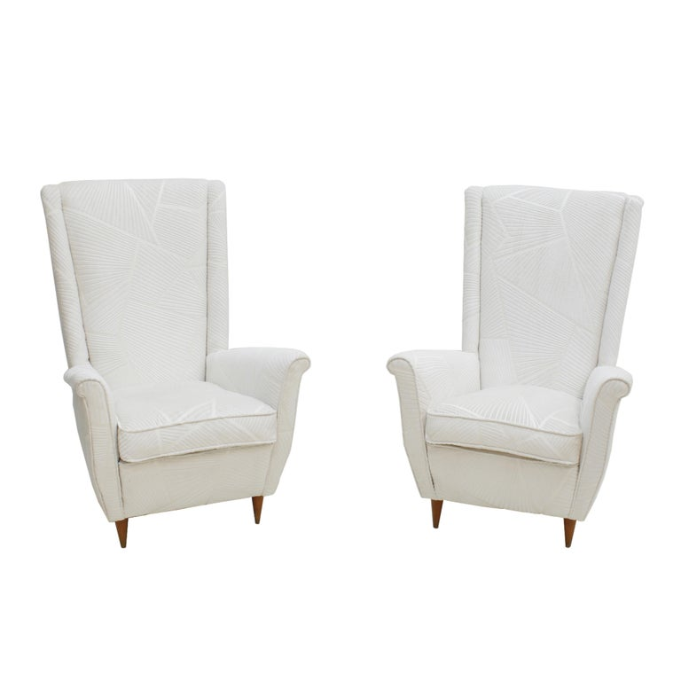 Pair of Italian armchairs made in wooden structure and conical legs. Upholstered in white velvet fabric model