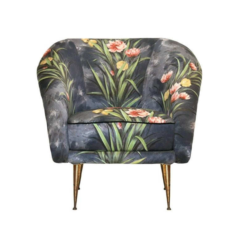 Mid-Century Modern pair of armchairs. Made of solid wood structure. Original hand painted upholstery with bronze conical shape legs, Italy, 1950s.
