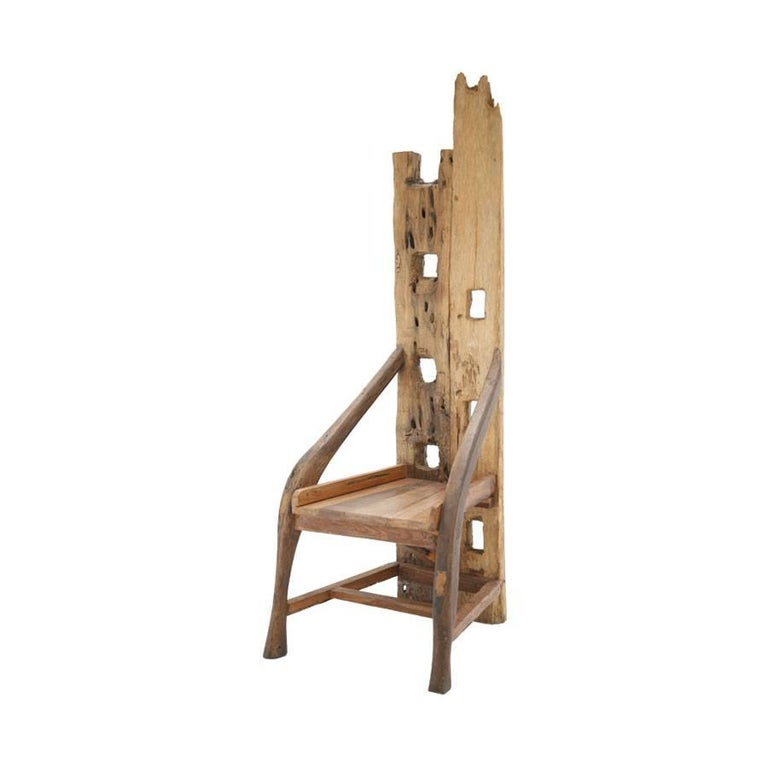 Mid-20th century sculptural chair. Composed of remains of ancient farming implements. Handmade of olive wood and walnut structure, France, 1940s.