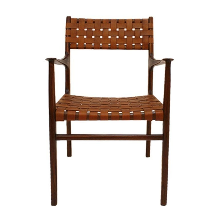 Mid-Century Modern set of eight chairs designed by Jens Risom (1916-2016). Made of solid rosewood structure. Seat and back composed of brown leather strips, USA 1950s.