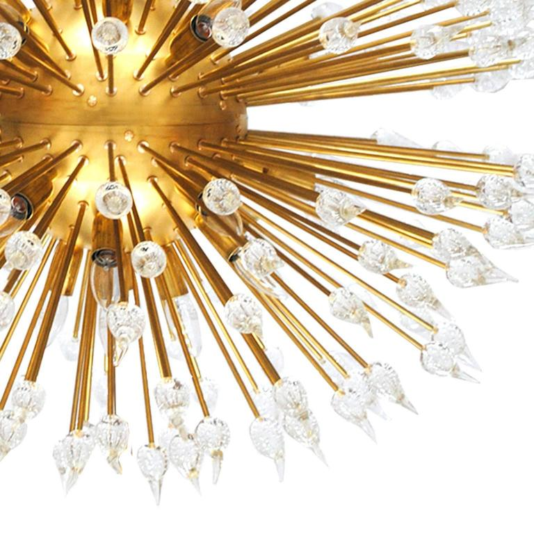 Suspension lamp with spherical structure made in brass composed by 380 rod made in solid brass and finished in Murano.