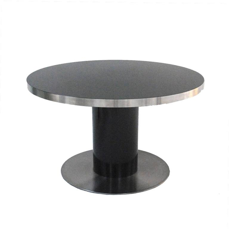 Pedestal table designed by Willy Rizzo, made in black lacquer solid wood finished in steel.