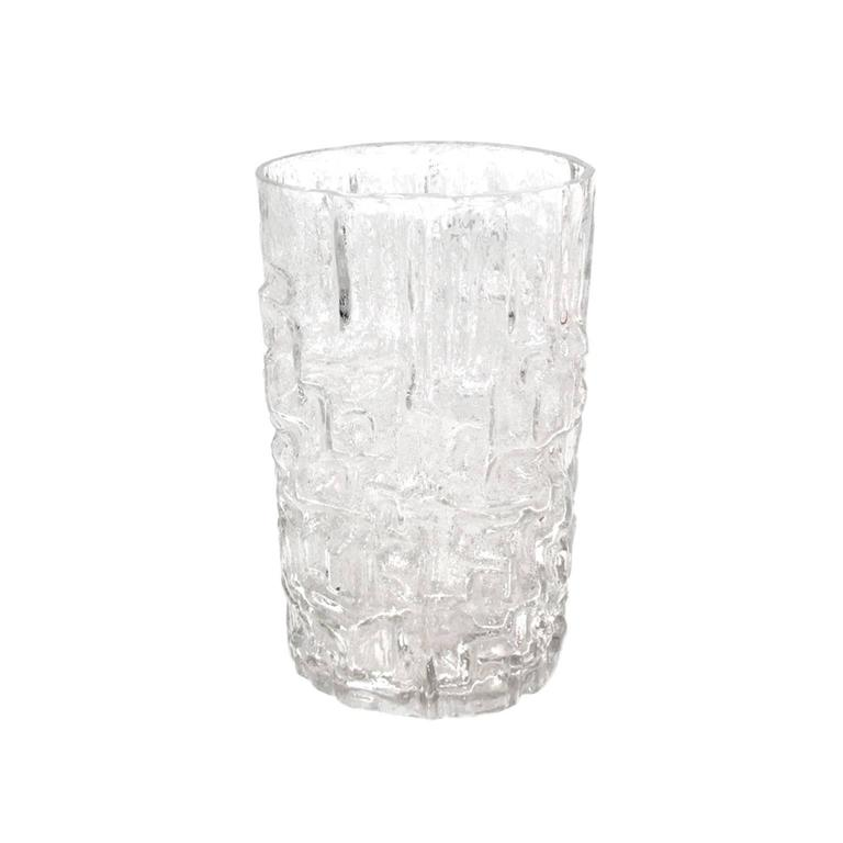 Vase made in solid carved crystal by Tapio Wirkkala inspired on brute iced forms.