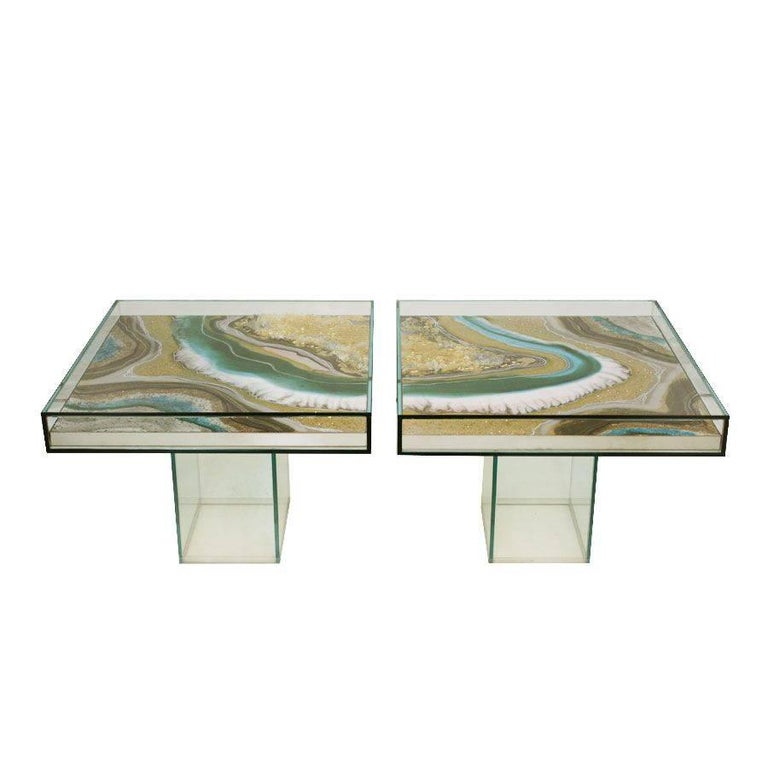 Pair of side tables designed by L.A. Studio made with different resins and pigments with crystal structure.