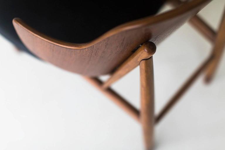 Designer: Ib Kofod-Larsen.   Manufacturer: Christensen & Larsen. Period or model: Mid-Century Modern. Specs: Beech and teak, leather.   Condition:   This Ib Kofod-Larsen chair for Christensen & Larsen are in excellent restored condition. The