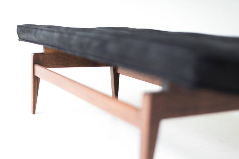 Designer: Jens Risom.   Manufacturer: Jens Risom Design Inc.  Period or model: Mid-Century Modern. Specifications: Walnut, leather.   Condition:   This Jens Risom bench for Risom Deign Inc. is in excellent restored condition. The walnut