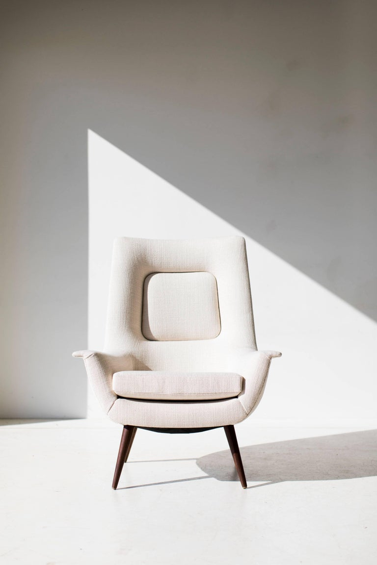 This Lawrence Peabody High Back Lounge Chair - P-1714 - Craft Associates® Furniture is expertly hand crafted and upholstered. This Peabody chair is licensed reintroduction for Craft Associates®. Each chair boasts hand cut high-density foam and high