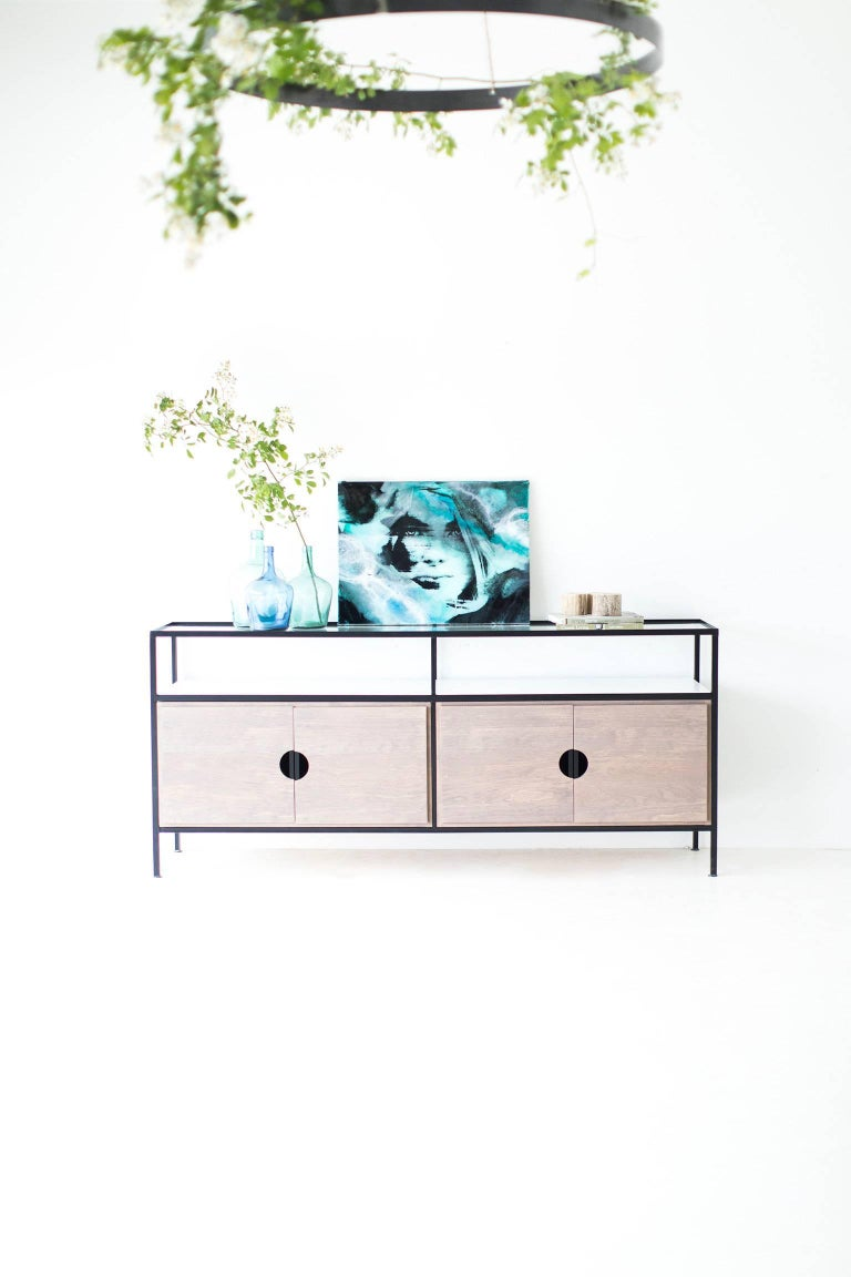 This Modern credenza is made in the heart of Ohio with locally sourced wood. Each unit is handmade with solid grey-washed pine OR black walnut and finished with a beautiful matte finish. The frame is hand welded steel and powder coated in matte