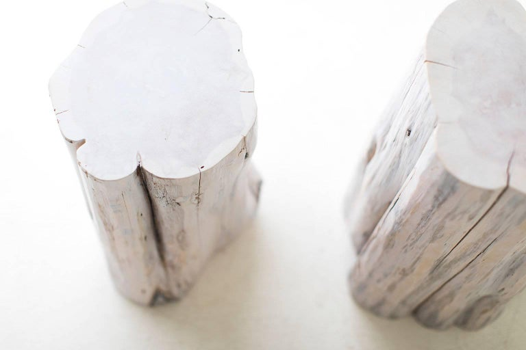 These tree stump tables are made in the heart of Ohio with locally sourced wood. They can be used for a side table, a stool, or grouped together as a coffee table. Each table is handmade with a solid trunk of red cedar with a white-wash finish.