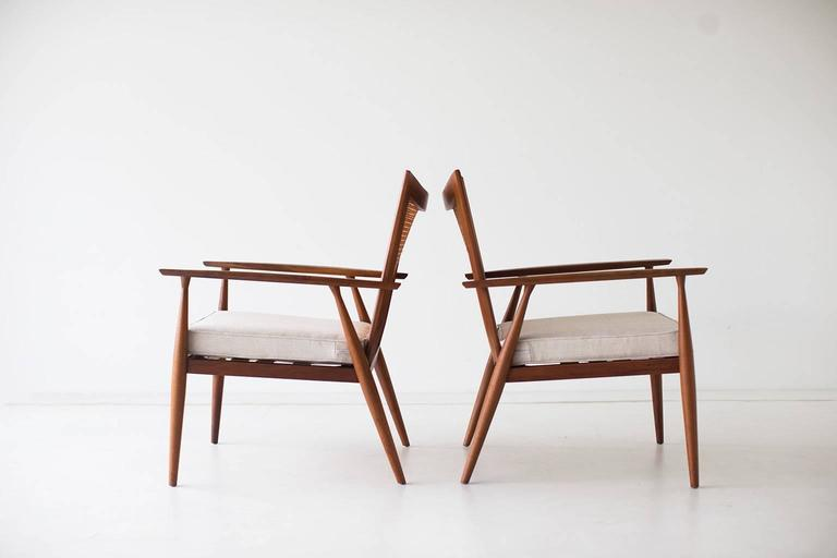 Designer: Paul McCobb.  Manufacturer: Winchendon. Period and model: Mid-Century Modern, Planner Group Series. Specifications: Maple (possibly walnut), caning, fabric.  Condition:  These Paul McCobb lounge chairs for Winchendon (Planner Group