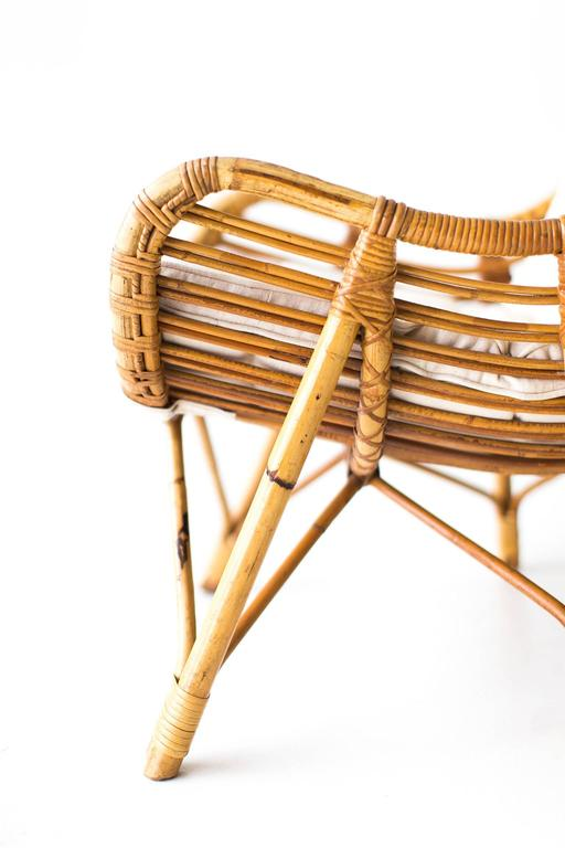 Designer: Unknown.  Manufacturer: Laurids Lonborg. Period or model: Mid-Century Modern. Specs: Bamboo, wicker, fabric.  Condition:   These Danish bamboo and wicker lounge chairs by Laurids Lonborg are in very good vintage condition. The