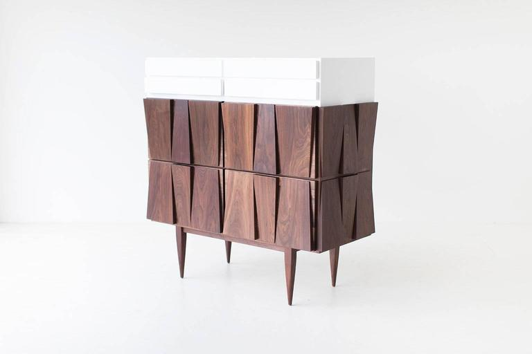 Modern Dresser - 1608 - Craft Associates® Furniture is expertly crafted. The base is constructed by hand from hard wood and not machine. The walnut is then shaped by artisans and finished with a hand applied oil. This piece is also available in