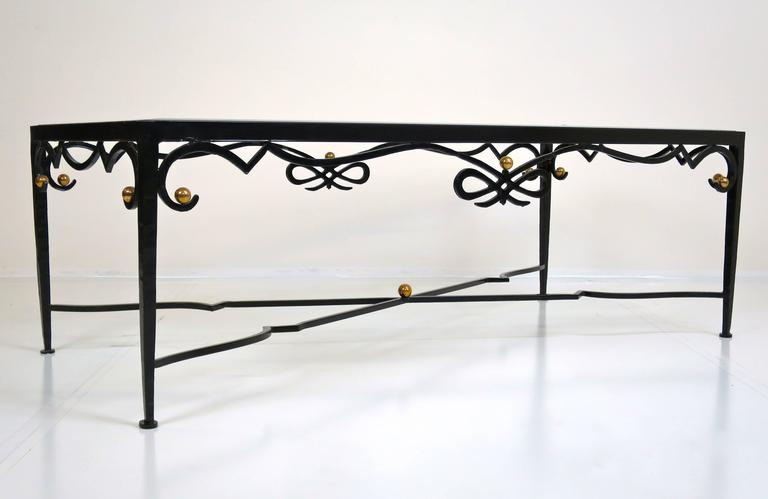 French cocktail table of forged iron with brass details