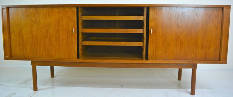 Tambour credenza in teak by Jens Herald Quistgaard for Lovig in restored condition. Excellent stainless detail to door hardware, as shown.