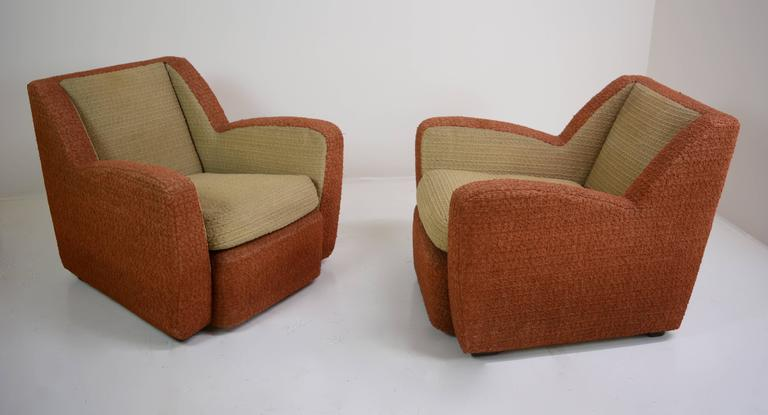 Exceptional pair of 1940s Italian club chairs sporting original fabric in outstanding condition with down filled cushions. Beautiful pair of chairs in very nice vintage condition. Measures: 36