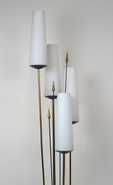 Elegant French floor lamp with four glass shades. In the manner of Maison Arlus. Very nice condition, circa 1950s.