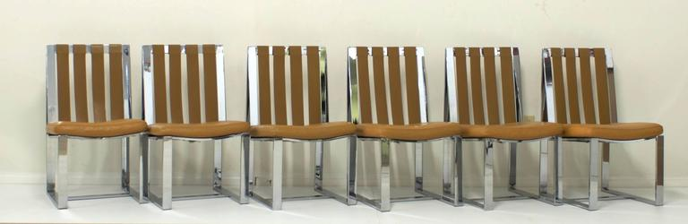 These rare chrome and mustard colored leather flat bar dining chairs by Milo Baughman for Thayer Coggin are from the 1970s. The chairs retain their original label. The set has the original leather strapping back and seats which have been