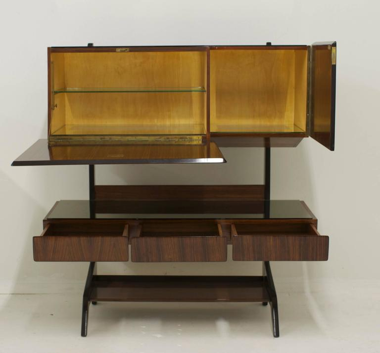 A spectacular cabinet attributed to Vittorio Dassi (1893-1973) Milan, 1955. Originally sold by G&G Longo in Rome. The dry bar has gorgeous wood inlay detail on the main keyed door which opens to reveal a glass shelf. The cabinet retains the