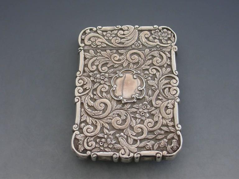 a rare victorian silver castle top card case of shaped rectangular form with chased and