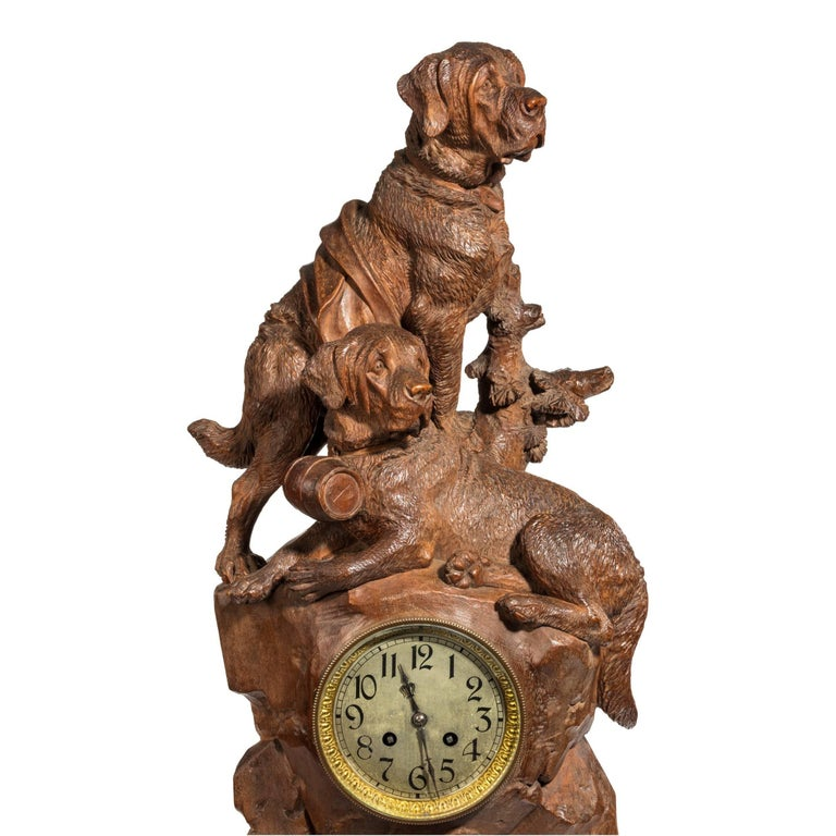 A very attractive walnut 'Black Forest' clock with mountain rescue dogs,   The clock set into a rocky outcrop surmounted by a pair of dogs, one wearing a collar with a barrel.