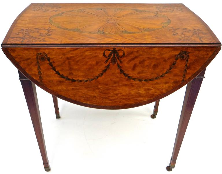 Of outstanding design and craftsmanship, this fine quality George III Pembroke table is attributed to Mayhew & Ince. The satinwood and tulipwood oval drop-leaf table is in excellent condition and carries with it noted provenance (see below). The