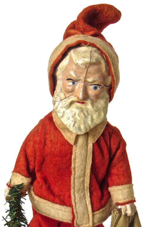 This rare and all original walking Santa Claus clockwork toy was manufactured in about 1890 and is probably of French manufacture, due to the lead feet and hand painted composition head, which was typical of French toy makers in that period.  It