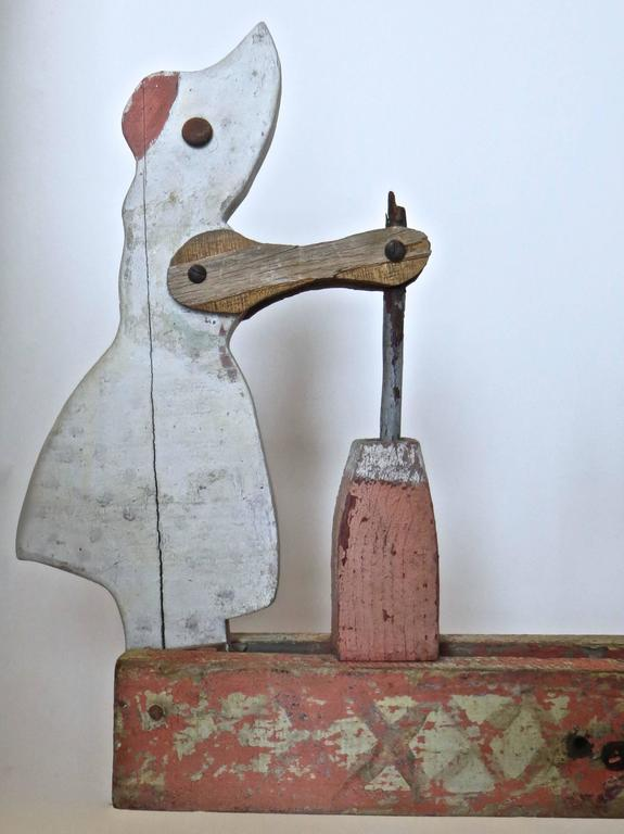 Folk Art Whirligig Depicts Woman Churning Butter, American, circa 1940 For Sale