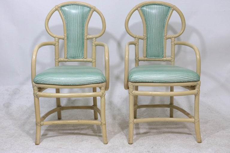 Midcentury pair of sophisticated stylish bone lacquered rattan Willow and Reed armchairs- scrolled and upholstered backs, curved stretchers and splayed legs-with label Recently re-upholstered in a beautiful Haute Couture Brunschig & Fils