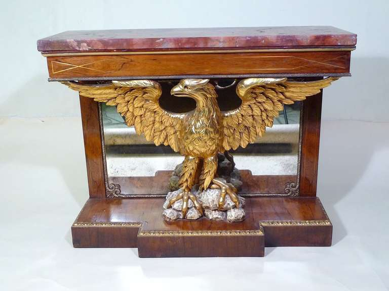 Very fine connoisseur antique english Regency style pier table in the manner of William Kent, circa 1860. Crafted from rosewood and mahogany featuring a magnificent detailed gilded eagle with spread wings and an original rouge specimen marble top.