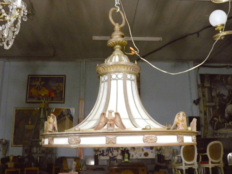 A 1900-1929 rare magnificent grand scale lobby chandelier by Edward F. Caldwell, a tour de force of American foundry cast and hand finished bronze and leaded glass fabrication, very heavy aged bronze vintage glass chandelier light pendant, featuring