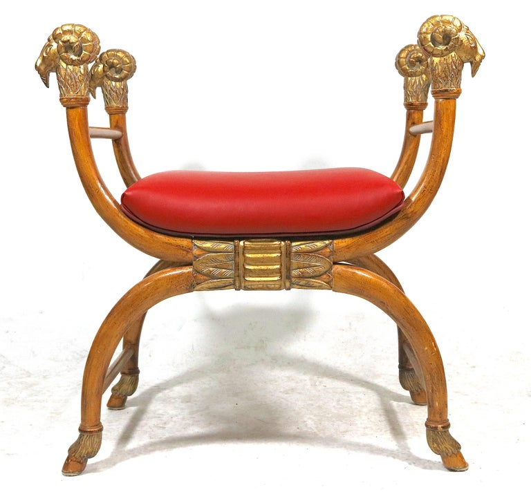 Haute style light wood bench with gilt carved curved arms ending in nicely detailed ram's head, Egyptian design carved centre apron, the curved legs terminate in  Carved Hoof-  Exotic Egyptian revival, grand scale bench. Mid-20th century New