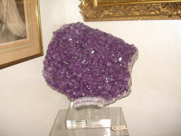 A 1950s lustrous large Brazilian specimen amethyst gem from the famed very sought after Minas Gerais (now closed mine) the finest Brazilian amethyst mine. This is a Gorgeous, large A grade specimen amethyst geode from Brazil. It is filled with
